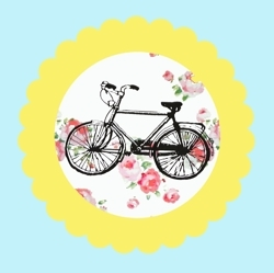 Yellow_bike_tag_on_blue_fabric__preview